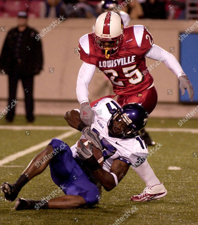 HARRIS Texas Christian's Cory Rodgers (17) is put to the ground by Louisville's Antoine Harris (25) following this reception in the second half at Papa John's Cardinal Stadium in Louisville, Ky., . No. 12 Louisville beat TCU, 55-28