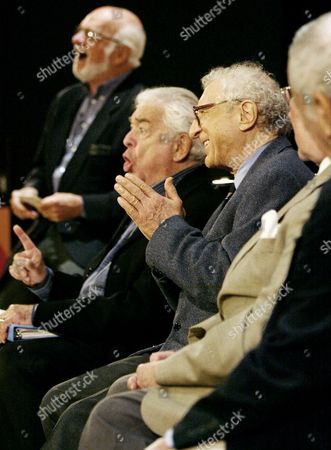 Composer Jerry Bock, second from left, makes a point while on a panel at the New York Public Library for the Performing Arts in New York, . Laughing are Harold Prince, left, and lyricist Sheldon Harnick third left