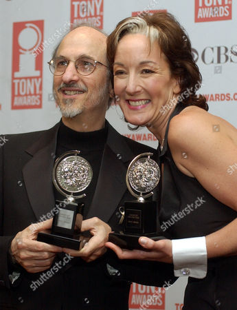 "Stock Photo of Jules Fisher, left, and Peggy Eisenhauer pose for photos with their Tony Award for Best Lighting design for ""Assassins"