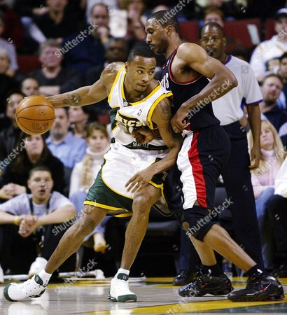 LEWIS ABDUR-RAHIM Seattle SuperSonics forward Rashard Lewis, left, pushes against Portland Trailblazers forward Shareef Abdur-Rahim as he drives toward the basket in the first quarter at KeyArena in Seattle