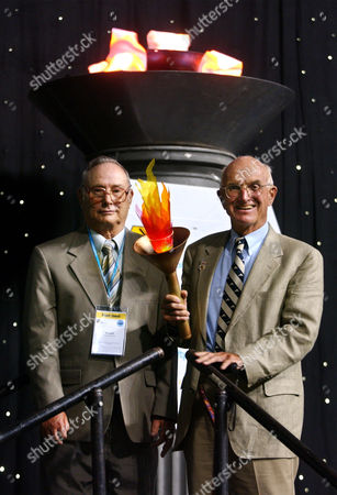 """Stock Image of MURRAY HERRICK Ronald Herrick, left, and Dr. Joseph E. Murray are shown after lighting a cauldron at the opening ceremonies of the 2004 U.S. Transplant Games in Minneapolis, . Fifty years ago on Dec. 23, 1954, Murray performed the first successful kidney transplant procedure, from Ronald Herrick into identical twin brother Richard, the victim of fatal kidney disease. Views regarding transplantation prior to this breakthrough were anything but enthusiastic. """"We were told it was impossible and that we were playing God and shouldn't do it,"""" says 85-year-old Murray, who eventually won a Nobel Prize for his achievement. The Transplant Games are held biannually by the National Kidney Foundation"""