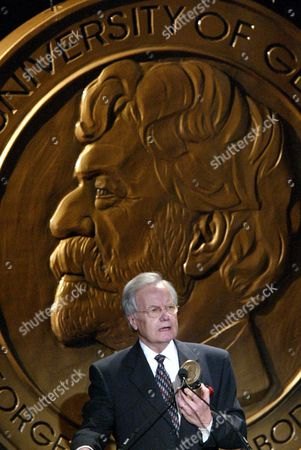 """MOYERS Bill Moyers gestures while accepting the Individual George Foster Peabody award during the 63rd annual Peabody awards luncheon in New York. Moyers was honored for career achievement, most recently his series """"Now with Bill Moyers"""" and the documentary """"Becoming American: The Chinese Experience"""