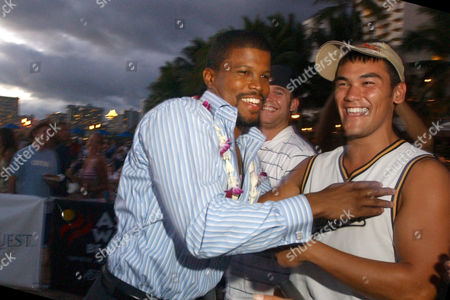 "ATKINS Sharif Atkins, left, playfully hugs a fan before the world premiere of NBC's new police series ""Hawaii"" on Waikiki Beach in Honolulu, Hawaii, . Atkins is one of the stars of the police series, one of four TV shows being filmed in Hawaii"