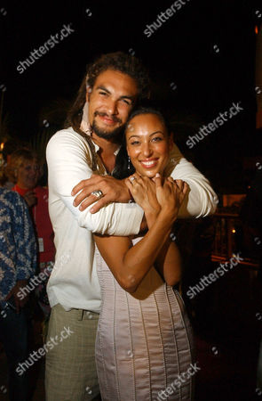 """Stock Picture of MAMOA SUMIKA Jason Momoa, one of the stars of Fox's """"North Shore,"""" congratulates Aya Sumika after the world premiere of NBC's new police series """"Hawaii"""" on Waikiki Beach in Honolulu, Hawaii,. Both shows are filmed entirely on the island of Oahu"""