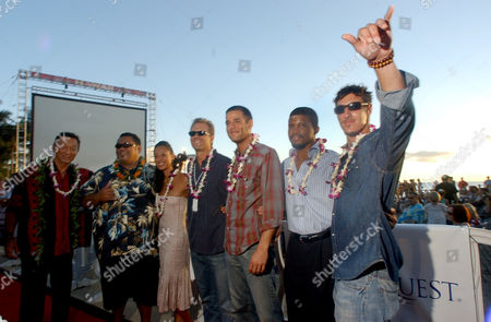 "The cast of the new NBC police series ""Hawaii"" poses on Waikiki Beach Sunday, Aug.29, 2004, in Honolulu, Hawaii. The show, which makes its network debut on Wednesday, premiered on the sands of Waikiki Beach on a 30-foot screen. From left to right are Carey Tagawa, Peter Navy Tuiasosopo, Aya Sumika, Michael Biehn, Ivan Sergei, Sharif Atkins, and Eric Belfour"
