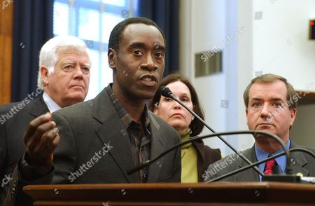 """ROYCE Actor Don Cheadle discusses his recent trip to the Darfur region of the Sudan with members of the U.S. Congress during a news conference on Capitol Hill . From left are: Rep. Jim McDermott, D-Wash., Cheadle, Rep. Betty McCollum, D-Minn., and Rep. Edward Royce, R-Calif. Cheadle is nominated for best actor in the Academy Awards for his role in the film """"Hotel Rwanda"""