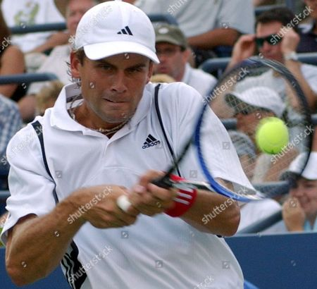JOHANSSON Joachim Johansson, of Sweden, makes a return against Jan-Michael Gambill, of the United States, at the U.S. Open tennis tournament in New York
