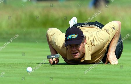 Joakim Haeggman, of Sweden, lines up a putt on the during the second round of the U.S. Open, at Shinnecock Hills Golf Club in Southampton, N.Y
