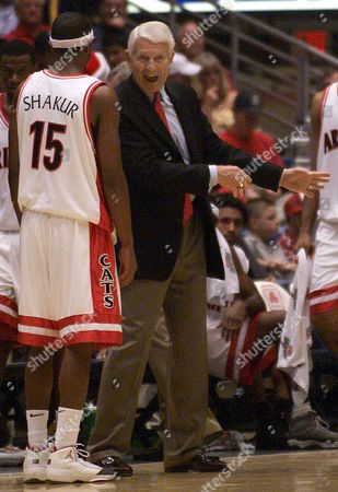 LUTE OLSON Arizona's head coach Lute Olson speaks with Mustafa Shakur (15) during the second half against Utah at McKale Center in Tucson, Ariz. on . Olson went on to win his 1,000th career coaching win after defeating Utah 67-62