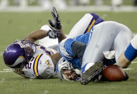 SHAW HARRIS Detroit Lions holder Nick Harris lays on the turf, right, after being tackled by Minnesota Vikings cornerback Terrence Shaw, left, after trying to handle a bad snap on an extra point attempt with just 12 second left in the game, in Detroit. Detroit's Roy Williams scored a touchdown to make the score 28-27 and the extra point would have tied the game. Minnesota beat Detroit 28-27