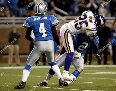 HANSON SHAW HARRIS Minnesota Vikings' Terrance Shaw (25) tackles Detroit Lions holder Nick Harris as place kicker Jason Hanson (4) looks on after a bad snap caused an aborted extra point attempt in the closing seconds of the fourth quarter in Detroit. Detroit Lions wide receiver Roy Williams had scored a touchdown with :12 left in the game and the extra point would have tied the game. The Vikings went on to beat the Lions, 28-27