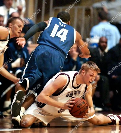Stock Picture of RAY MALLON Villanova's Allan Ray (14) knocks down Saint Joseph's Dave Mallon in the first half, in Philadelphia. At rear is St. Joseph's Chet Stachitas