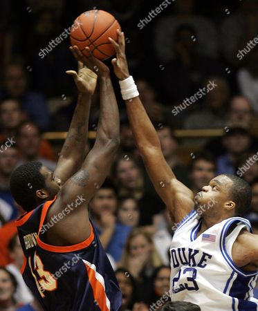 Stock Picture of WILLIAMS BROWN Duke's Shelden Williams, right, gets his hand on a shot by Virginia's Elton Brown during the first half at Cameron Indoor Stadium in Durham, N.C. Sunday, Jan.16, 2005