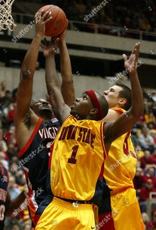 STINSON HOMAN SMITH Iowa State's Curtis Stinson (1) battles for a rebound with teammate Jared Homan, right, and Virginia's Devin Smith, left, during the second half, in Ames, Iowa. Stinson scored 30 points as Iowa State won 81-79