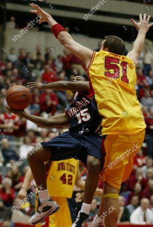 BANNISTER HOMAN Virginia's T.J. Bannister, left, drives to the basket past Iowa State's Jared Homan (51) during the first half, in Ames, Iowa