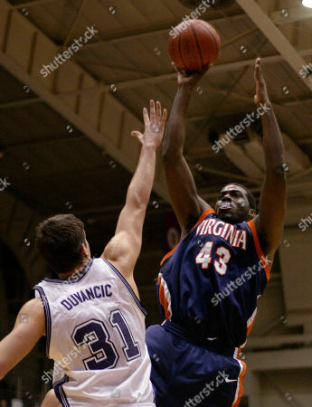 DUVANCIC BROWN Virginia's Elton Brown (43) shoots over Northwestern's Davor Duvancic (31), of Croatia, during the first half, in Evanston, Ill