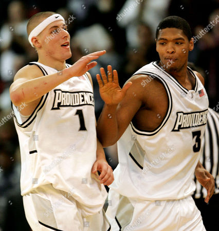Stock Image of GOMES MCGRATH Providence's Ryan Gomes, right, congratulates teammate Donnie McGrath after McGrath hit a 3-pointer during the second half against Virginia, in Providence, R.I. McGrath hit all nine of his 3-point attempts for a career-high 27 points and Gomes added 20 points, helping Providence end a seven-game losing streak with a 98-79 win