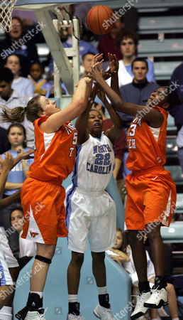ATKINSON GIBSON CHRISS North Carolina's La'Tangela Atkinson (22) battles with Virginia Tech's Erin Gibson, left, Dawn Chriss, right during the first half, at Carmichael Auditorium in Chapel Hill, N.C