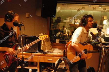 John Stirratt, left, and Jeff Tweedy, of the music group Wilco, perform in New York, prior to an NPR (National Public Radio) recording