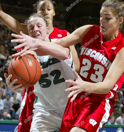 Stock Photo of SHIMEK WILSON WARD Michigan State's Liz Shimek (52) and Wisconsin's Jordan Wilson (23) battle for a rebound in the second half, in East Lansing, Mich. Shimek led Michigan State with 22 points and nine rebounds in a 74-66 win. At rear is Wisconsin's Danielle Ward