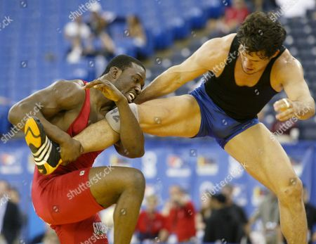 LAWAL Muhammed Lawal, left, of Stillwater, Okla., works to take down Aaron Simpson of Tempe, Ariz., during their 84kg/185 lbs Freestyle match at the U.S. Olympic Wrestling Team Trials, in Indianapolis. Lawal won, 3-1