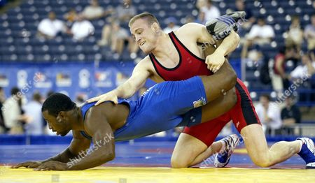 SANDERSON Cael Sanderson, top, of Ames, Iowa, works for control of Muhammed Lawal, of Stillwater, Okla. during their 84kg/185 lbs. Freestyle match at the U.S. Olympic Wrestling Team Trials, in Indianapolis. Sanderson won 7-2
