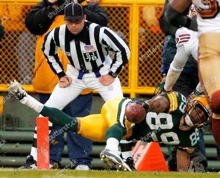 FERGUSON Referee Greg Meyer watches as Green Bay Packers receiver Robert Ferguson dives in the endzone for a touchdown reception in the second quarter against the San Francisco 49ers, in Green Bay, Wis