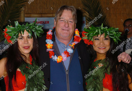 """CLARK Actor Blake Clark poses for a photo with dancers as he arrives at the premiere of Columbia Pictures """"50 First Dates"""" at Mann Village, in Los Angeles"""