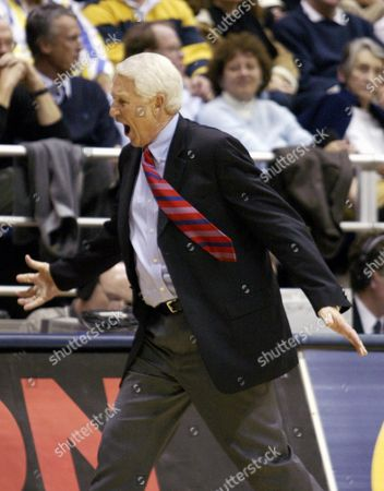 OLSON Arizona coach Lute Olson shouts as he paces during the second half as Arizona trails California, in Berkeley, Calif. California won 87-83 over No. 12 Arizona