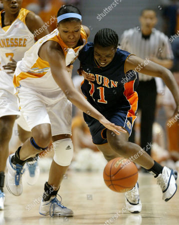 LOUDEN ROBINSON Auburn's Nichole Louden (11) battles for the ball with Tennessee's Ashley Robinson during the first half, in Knoxville, Tenn