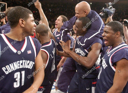 Connecticut players celebrate after defeating Pittsburgh in the Big East Championship finals in New York. UConn won 61-58. From left to right are: Rashad Anderson, Taliek Brown, Josh Boone, Emeka Okafor, Charlie Villanueva and Shamon Tooles
