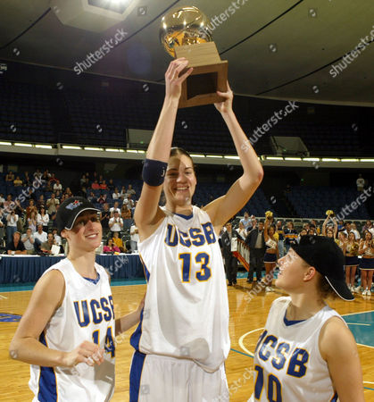 Stock Photo of TAYLOR WILLETT MCDIVITT Tournament MVP UC Santa Barbara's Lindsay Taylor holds up the championship trophy with teammates Lisa Willett, left, and April McDivitt after their victory over Idaho in the Big West women's tournament in Anaheim, Calif. on . UC Santa Barbara won 68-51
