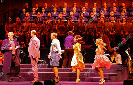 """From left to right, Sir Thomas Allen as Dr. Pangloss; Jeff Blumenkrantz as Maximillian; Paul Groves as Candide; Janine LaManna as Paquette; and Kristin Chenoweth as Cunegonde sing during the dress rehearsal of the New York Philharmonic's presentation of """"Candide"""" the musical at the Lincoln Center in New York on"""