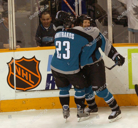 HARVEY DIMITRAKOS San Jose Sharks right wing Todd Harvey, right, is hugged by right wing Niko Dimitrakos after Harvey scored past the Vancouver Canucks in the first period, in San Jose, Calif