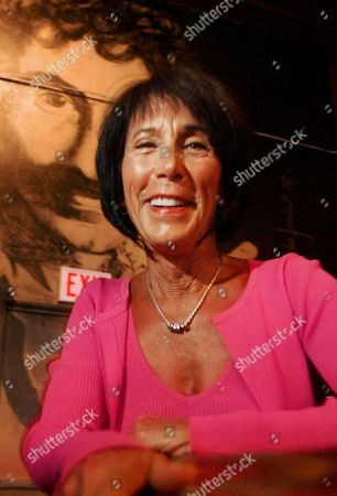 """Stock Picture of CROCE Ingrid Croce, widow of singer Jim Croce, poses for a photo in front of a mural depicting her late husband at Croce's Restaurant, in San Diego. Some 30 years after Croce's death in a plane crash, Ingrid and their son are rereleasing the album, """"Facets,"""" a combination of songs by composers Croce admired and his own early work, along with a DVD of his performances and an early session recorded at the family's kitchen table"""