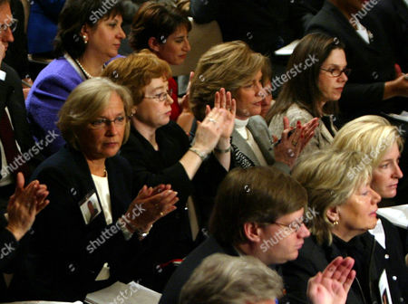 SANDERS FETCHET MCGOWAN From right in second row, Martha Sanders of Darien, Conn., Mary Fetchet of New Canaan, Conn., and Terry McGowan of New York sit with other relatives of victims of the Sept. 11, 2001, attacks as they applaud the federal panel reviewing the attacks, in Washington. National security adviser Condoleezza Rice testified before the commission Thursday
