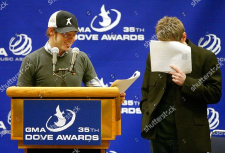 """MCKEEHAN CHAPMAN Christian artist Steven Curtis Chapman, right, hides his face as artist Toby McKeehan, left, reads his name for one of his seven nominations including Song Of The Year for """"All About Love"""" as they read the nominations for the Gospel Music Association's 35th Dove Awards, in Nashville, Tenn"""