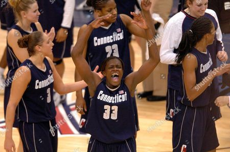 Stock Photo of MOORE Connecticut's Barbara Turner, center, reacts to the crowd after their team's 66-49 win over Penn State in the NCAA East regional Championship game in Hartford, Conn., . At left is Connecticut's Diana Taurasi and at right Jessica Moore with from left at rear, Ann Strother, Willnett Crockett and Liz Sherwood