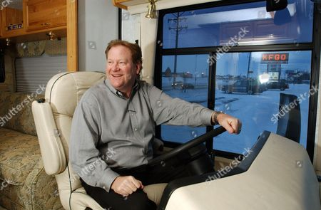 """Radio talk show host Ed Schultz sits behind the wheel of a 28-foot motor home in Fargo, N.D., . Schultz does broadcasts from the portable studio while on the road. """"The Ed Schultz Show"""" promises """"straight talk from the heartland"""" _ meaning, not from those out-of-touch-with-the-common-man liberals in Los Angeles or New York"""