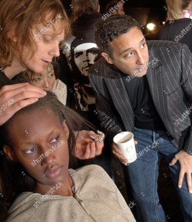 Designer Jeff Mahshie, right, works with stylist Josh B. and model Jaunel on the placement of a diamond pin for her hair that she will wear in the fall/winter 2004 collection of Chaiken shown in New York