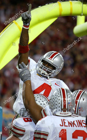 HOLMES Ohio State's Santonio Holmes is hoisted by temmates Ben Hartsock (88) and Michale Jenkins (12) as he celebrates a touchdown in the third quarter against Kansas State at the Fiesta Bowl, in Tempe, Ariz