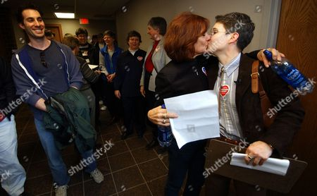 MARRA ALEXANDER Meredith Alexander gets a kiss from her partner Kim Marra, right, while waiting to apply for a marriage license, at the Johnson County Government Building in Iowa City, Iowa. Gay and lesbian couples were denied marriage licenses Friday by Johnson County Recorder Kim Painter, who says she is the only openly gay elected official currently serving office in the state who said she must uphold the law
