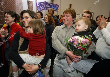 BAIRD Rene Baird, right, holds her fifteen-month-old son Gabriel as her partner Sara Baird, left, holds their three-year-old daughter Olivia after their application for a marriage license was denied, at the Johnson County Government Building in Iowa City, Iowa. More than 40 gay and lesbian couples were denied marriage licenses Friday by Johnson County Recorder Kim Painter, who says she is the only openly gay elected official currently serving office in the state