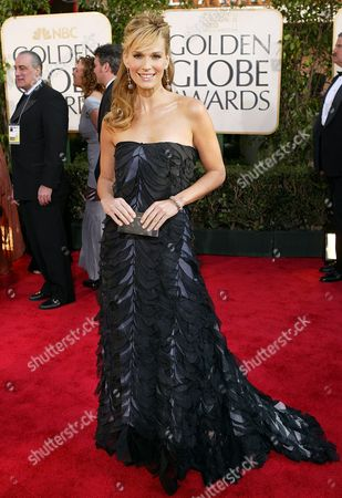 SIMMS Model and actress Molly Sims arrives for the 61st Annual Golden Globe Awards, in Beverly Hills, Calif., where she will be a presenter during the show