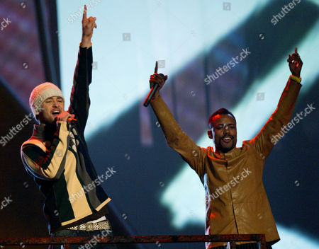 "TIMBERLAKE Justin Timberlake, left, performs ""Where is the Love"" with the Black Eyed Peas during the 46th Annual Grammy Awards, in Los Angeles"