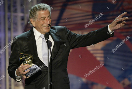 "BENNETT Tony Bennett dedicates his award to singer Rosemary Clooney who died in 2002 during the 46th Annual Grammy Awards, in Los Angeles. Bennett won with singer k.d. lang for best traditional pop vocal album for their ""A Wonderful World"