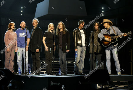 Stock Photo of YOAKAM Participants in a tribute to musician Warren Zevon, who died on Sept. 7, 2003, after battling lung cancer, rehearse for the Grammy Awards show, at the Staples Center in Los Angeles. From left: Ariel and Jordan Zevon, Zevon's children; Jorge Calderon, producer and writer who collaborated with Zevon; a stand-in for Emmylou Harris who identifed herself as Kim; Timothy B. Schmidt of the Eagles; actor Billy Bob Thornton; musicians Jackson Browne, and Dwight Yoakam. The Grammy Awards will be presented Sunday, Feb. 8
