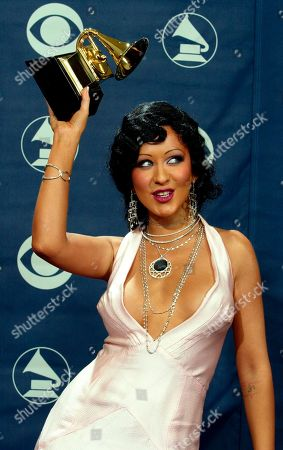 "AGUILERA Christina Aguilera holds the award for best female pop vocal performance award for ""Beautiful"" from her ""Stripped"" album at the 46th Annual Grammy Awards, in Los Angeles"