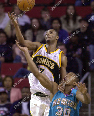 LEWIS WEST Seattle SuperSonics' Rashard Lewis, left, fouls New Orleans Hornets' David West as the two vie for a rebound in the second half, in Seattle. Lewis had 14 points in the Sonics' 96-88 win