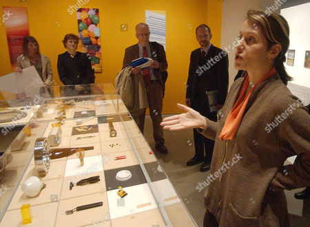 """Paola Antonelli, right, curator of """"Humble Masterpieces,"""" an exhibition showcasing masterfully designed everyday objects, gestures while speaking at The Museum of Modern Art's Queens space Wednesday, April, 7, 2004, in New York. The Exhibit opens April 8 and will continue through"""
